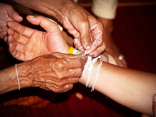 Elderly hands helping a young person
