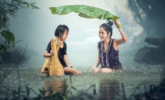 Woman and child feeling good in the rain and with each other